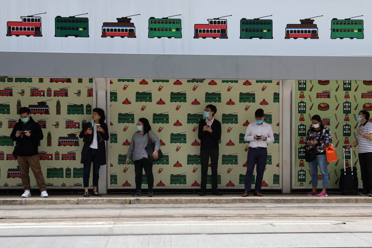 People keep their distance while waiting for a tram in the Central district of Hong Kong. Photo: Nora Tam